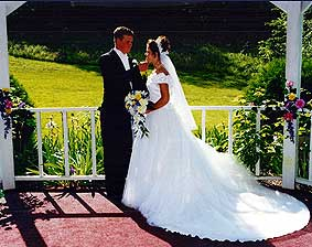 Married couple in the gazebo at In the Smokies Weddings